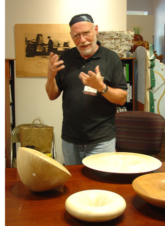 Siegfried discusses his work, some of which can be seen on the table in front of him.