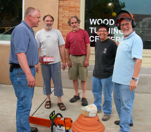 During a break from loading boxes, David Bender of the WTC took this group photo of us with the guy from Stihl who brought us a new chainsaw.
