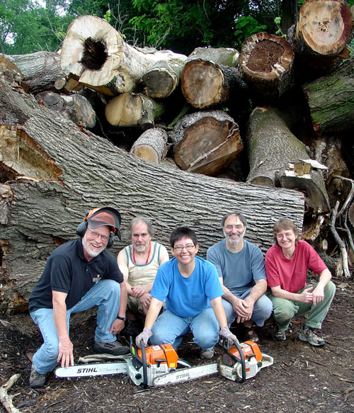 Siegfried, Sean, me, Jean-François, and Jane at the wood dump. J-F wants part of the hollow oak log we are squatting in front of.