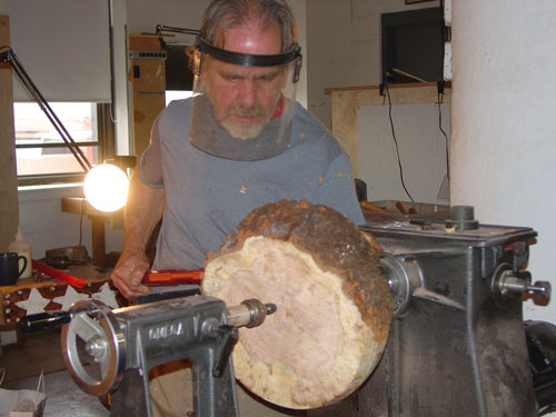 Sean works on a maple burl vessel.