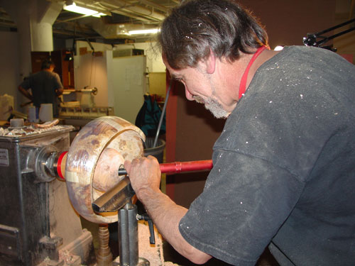 Sean continues work on the burl vessel.