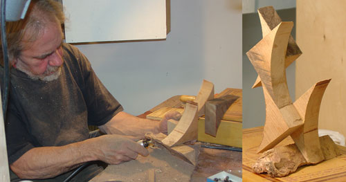 Sean works on carving a freeform scupture.