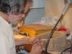 Sean prepares to cut the oak ring he has turned.