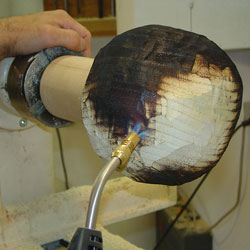 The shaped vessel being torched.