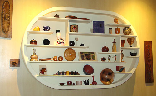In the Breslers' foyer, a thank-you gift from the Wood Turning Center, with pieces from some 30 artists.