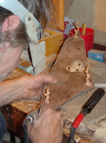 Sean works on the walnut bowl.