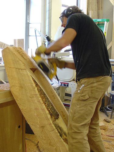 Peter uses a power planer.