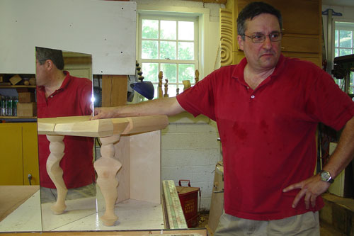 Mark uses a mirror to simulate the opposite leg of a model.