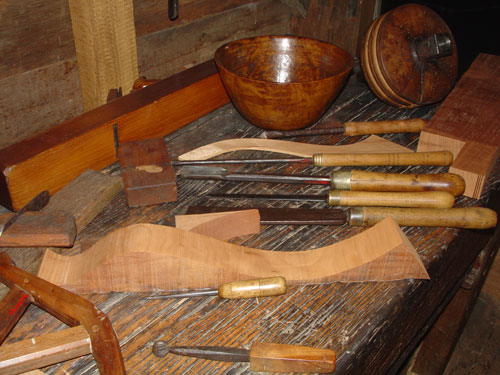Lathe tools and a turned bowl.