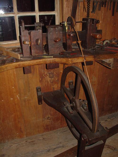 Metal lathe in the clock-making shop.