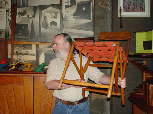 Paul shows us the hammer handle chair.