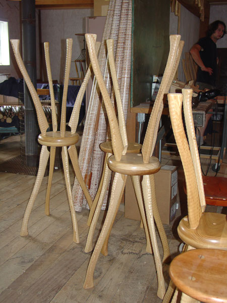 Stacked stools and bedposts.