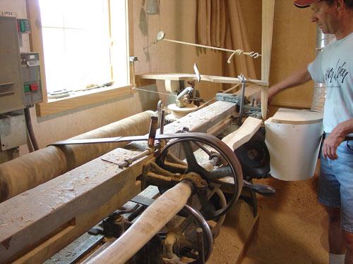 Turning axe handles.