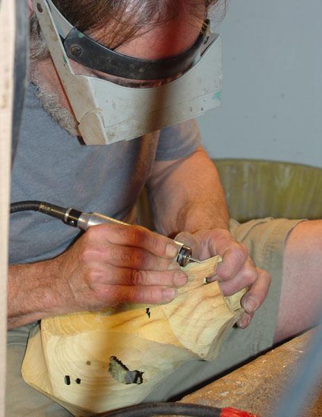 Sean carves a new piece.