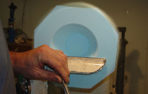 Jean-François turns a Styrofoam form.