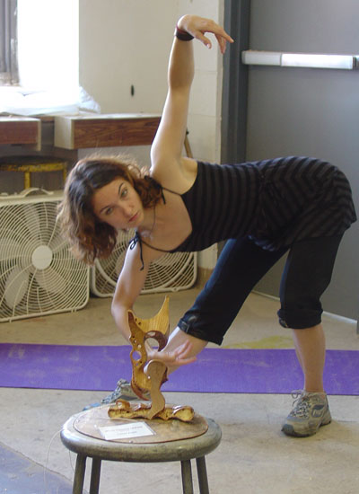 Lesya dances to Sean's sculpture.