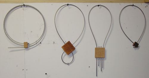 More cable-and-wood necklaces.