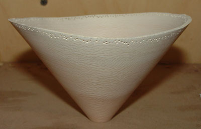 A small, carved sycamore bowl.