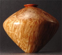 Maple burl hollow vessel with massadaruba collar